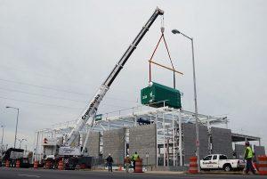 A Crane Truck On A City Street